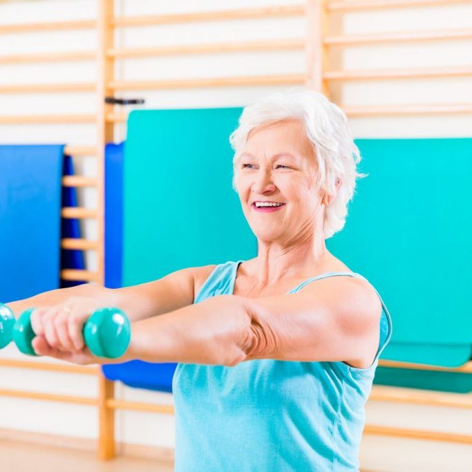 37922696 - senior woman doing fitness sport in gym with dumbbells